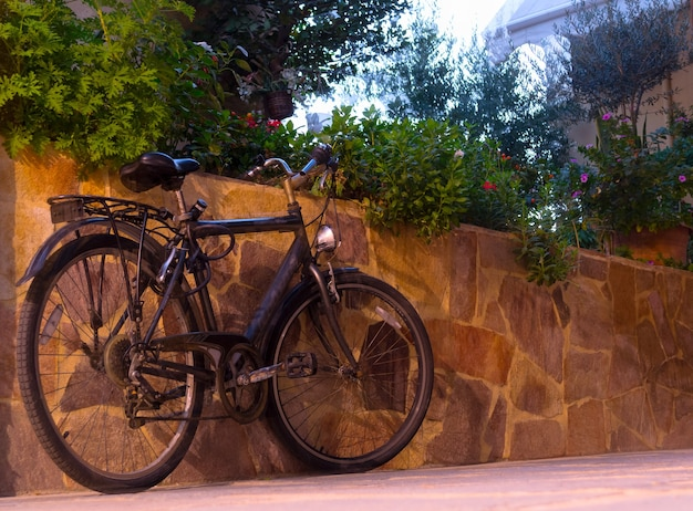 Lonely bike in the old stone street of crete, greece