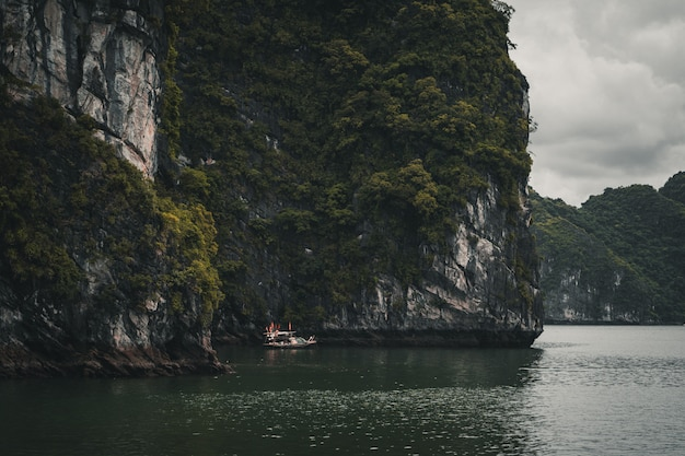 Lonely boat in ha long bay