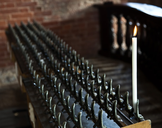 Lonely candle in a italian abbey. concept of hope, faith, loneliness