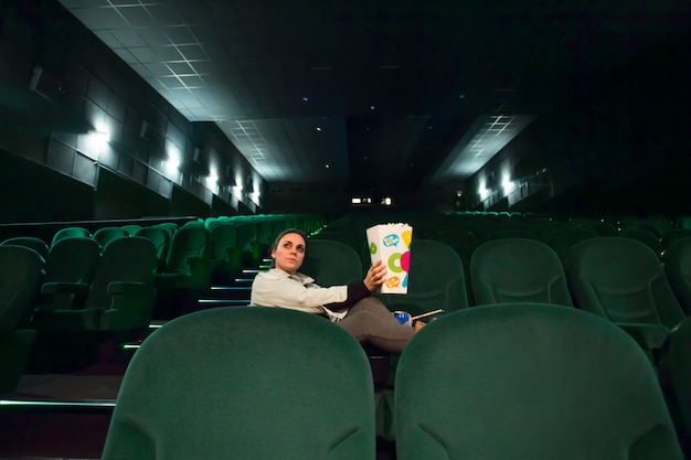 Lonely girl in big cinema hall