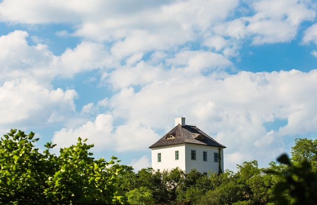 Lonely house on top of hill with blue sky