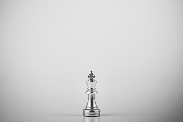 Lonely king chess standing on white background.