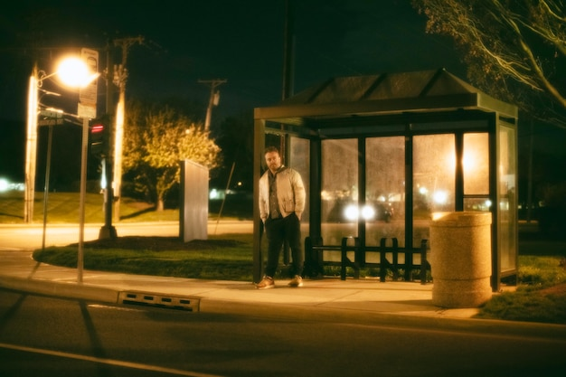 Lonely man at the bus station in the city at night
