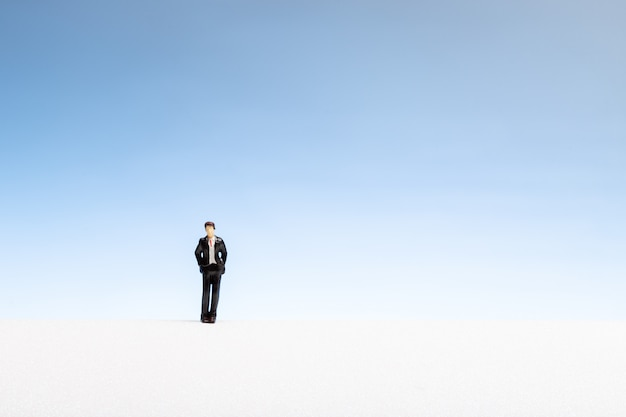 Lonely man concept. man miniature on gradient copyspace