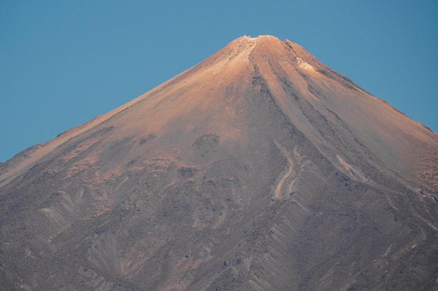 Lonely mountain peak by the sunset