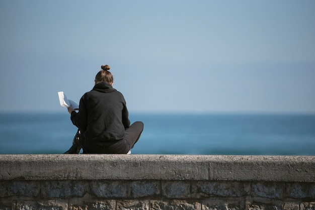 Lonely person looking at the sea