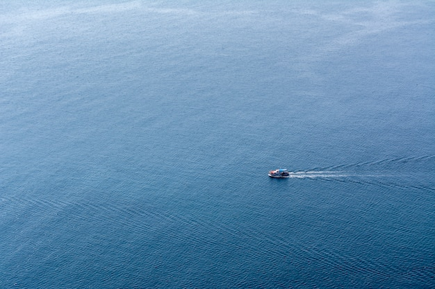 Lonely small boat sailing in the sea.