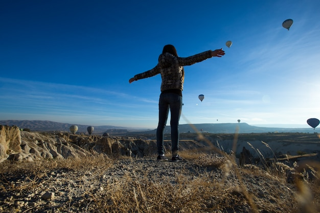 Lonely traveler looking into the cappadocia, central anatolia, turkey