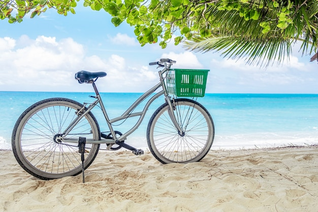 Lonely vintage bicycle on the tropical sandy beach