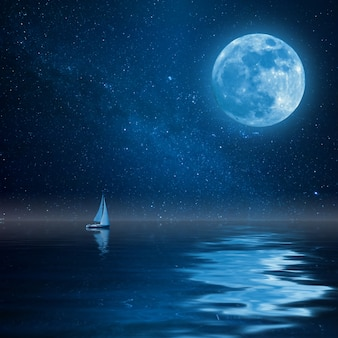 Lonely yacht in calm ocean, full moon and stars reflection in water