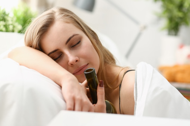 Lonely young woman sleeps early in the morning