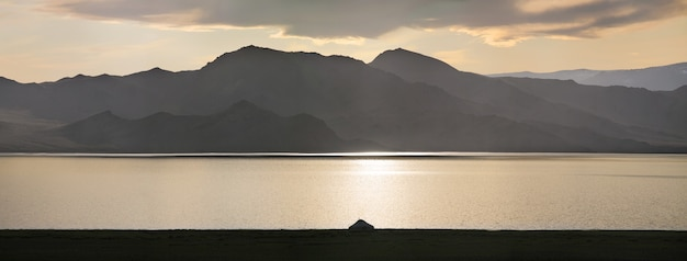 Lonely yurt on the shore of a mountain lake in mongolia