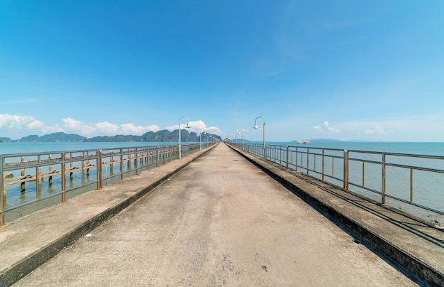 The long bridge in to the sea with beautiful nature view at phang nga thailand concept travel background and tour in summer season.travel  website background.