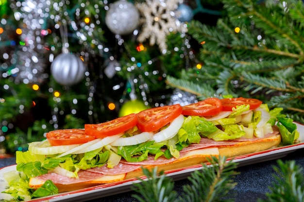 Long delicious sub with muenster cheese, salami, and vegetable on christmas tree