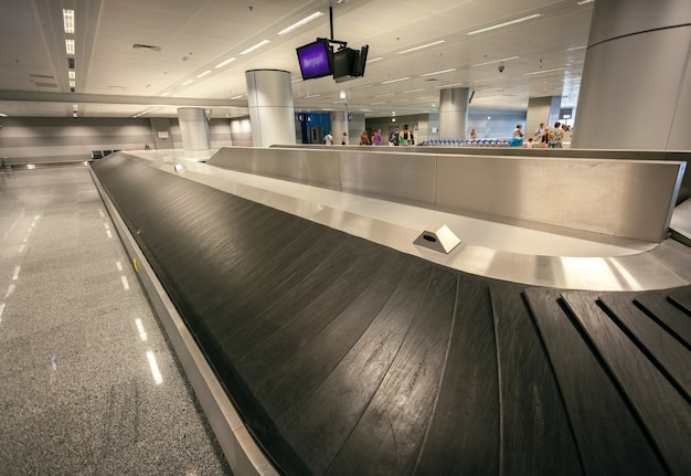 Long empty luggage claim line in airport