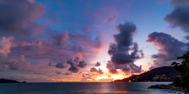 Long exposure colorful sunset or sunrise over sea clear sky sunset with reflection light on sea surface idyllic amazing landscape climate change beauty in nature environment.