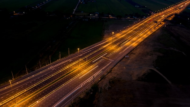 Long exposure at night traffic car transportation in thailand aerial top view