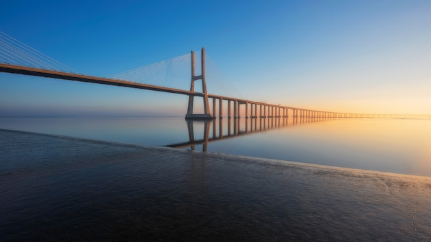 Long exposure of vasco de gama bridge lisbon portugal