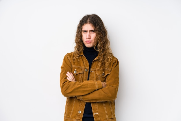 Long hair man posing isolated unhappy looking in front with sarcastic expression