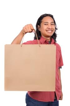 Long hair man with paper bag