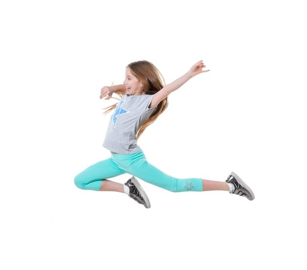 長い髪のアクティブな女の子のダンス、分離