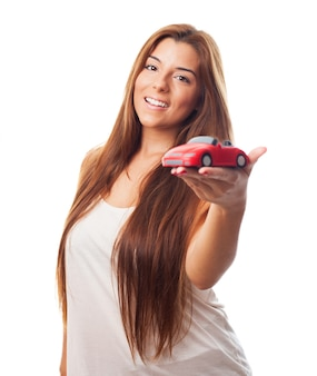 Long haired beauty with tiny car
