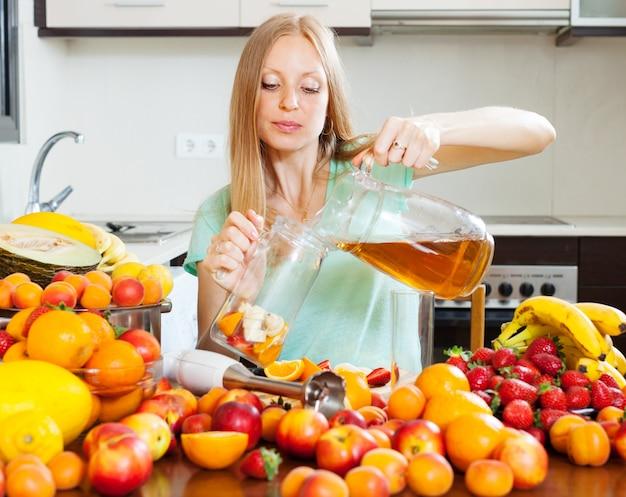 Long-haired girl making fresh beverages
