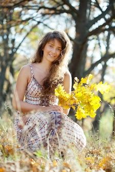 Long-haired girl with oak posy
