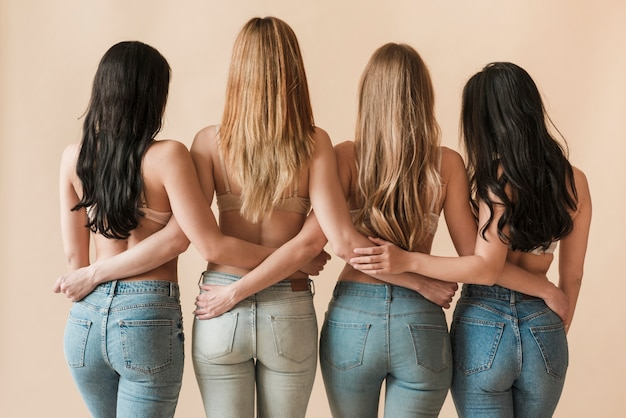Long haired slim women standing together in row