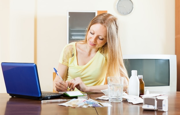 Long-haired woman reading about medications  in internet