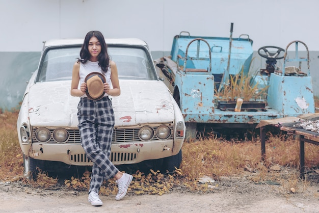 Long-haired young hipster girl with old car , vintage