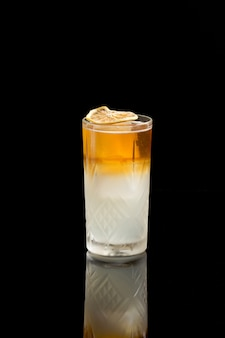 Long island ice tea cocktail  isolated on a black background.