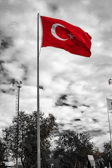 Long mast turkish flag with cloudy gray sky