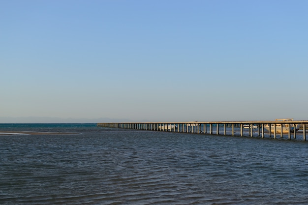 Long pier in the sea evening