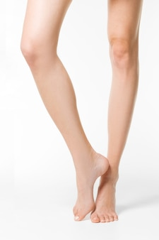 Long pretty woman legs isolated on white.