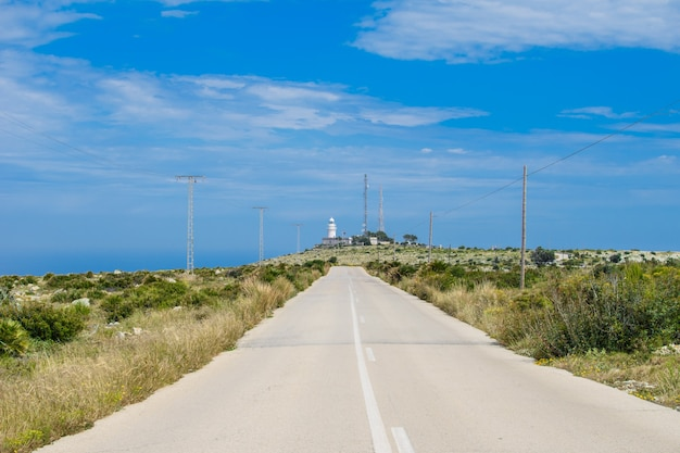 Long road to the lighthouse of san antonio, near the city of denia costa blanca in spain.