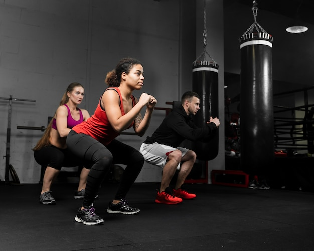 Long shot athletic people training for boxing competition