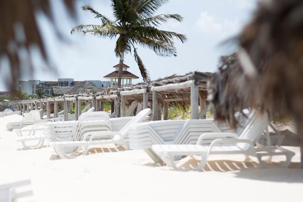 Long shot of beach chair in tropical resort