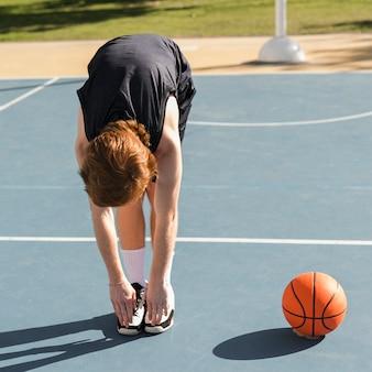 Long shot of boy with basketball ball