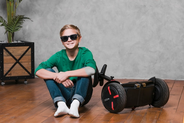 Long shot of boy with hoverboard