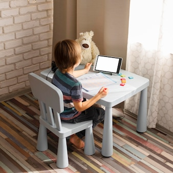 Long shot child attending virtual school courses