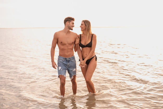 Long shot of couple spending time in water