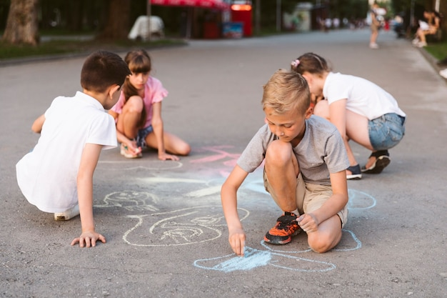Long shot friends drawing with chalk