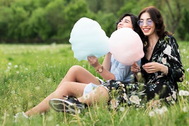 Long shot friends eating cotton candy
