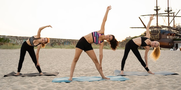 Long shot of girls exercising on beach