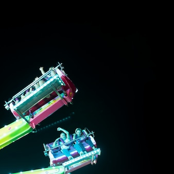 Long shot happy couple in amusement ride