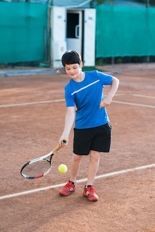 Long shot kid playing tennis