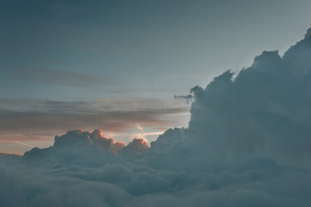 Long shot landscape of foggy clouds from above the sky