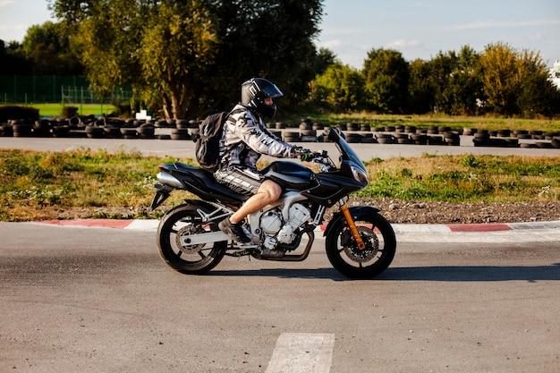 Long shot male on motorbike