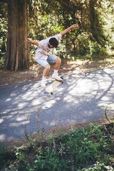 Long shot of man doing tricks